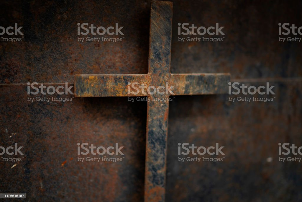 rusty cross - old and rusty cross iron door – rusty grunge background royalty-free stock photo