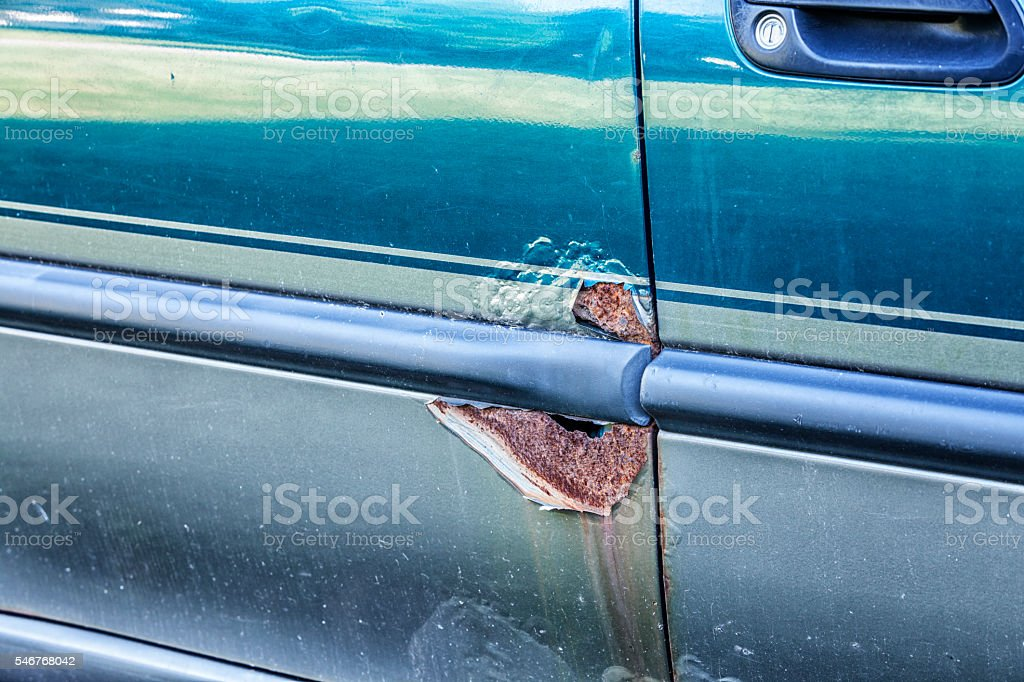 Rusty Damaged Metal Corrosion Holes On Car Vehicle Door stock photo