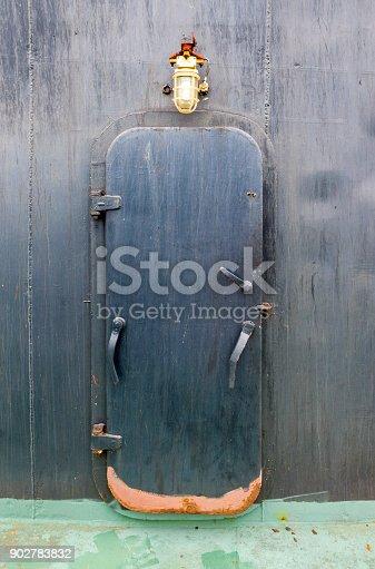 istock Rusty door on the cargo ship 902783832