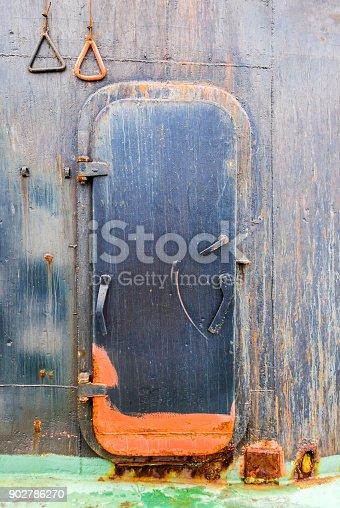 istock Rusty door on the cargo ship 902786270