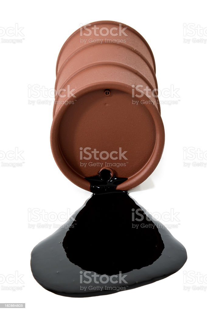 Rusty drum spilling crude oil royalty-free stock photo