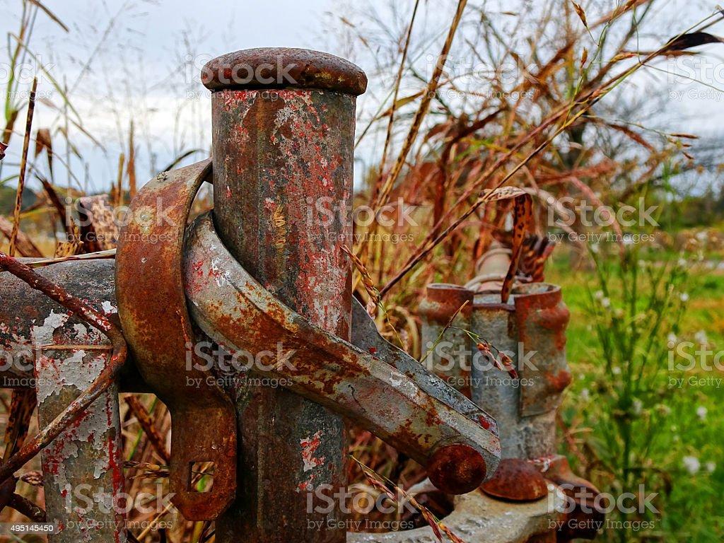 Rusty Fence Post stock photo