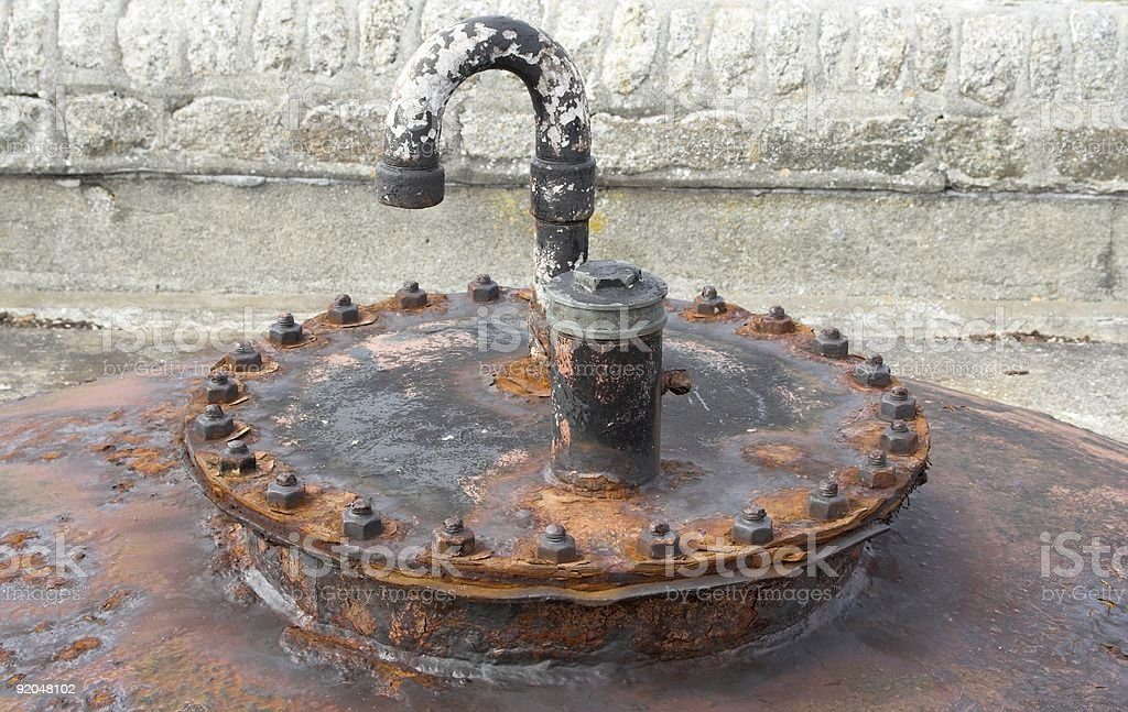 Rusty Flange Plate On Industrial Storage Tank royalty-free stock photo