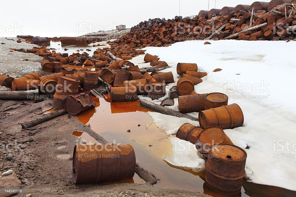Rusty fuel and chemical drums stock photo