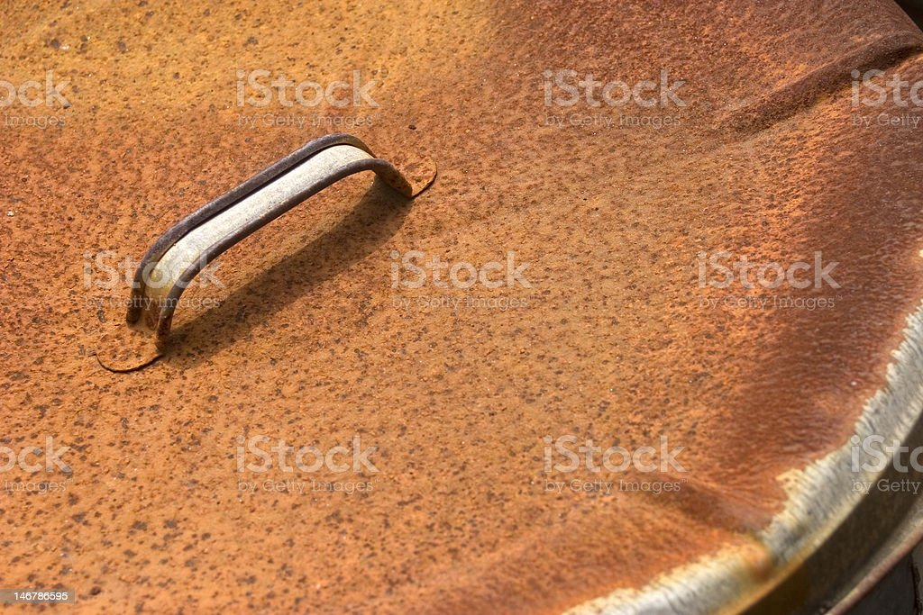 Rusty Garbage Can Lid stock photo