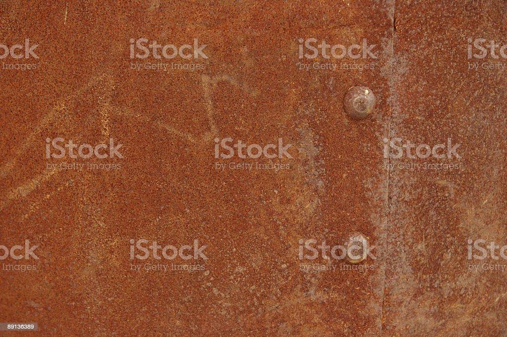 Rusty Grunge Background, Sheet Metal, Rivet, Orange, Close-Up royalty-free stock photo