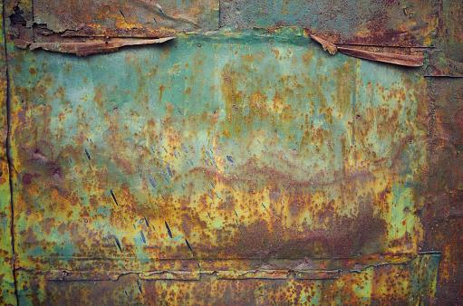 Rusty grunge green crumpled empty shiny sheet metal wall texture background