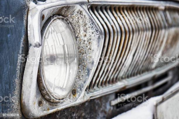 Rusty headlight of old soviet car