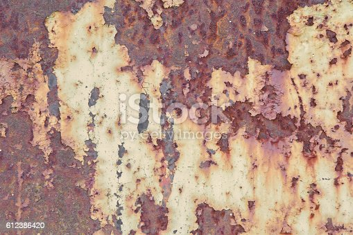 165581167istockphoto Rusty iron plate with shabby paint. Texture background. 612386420