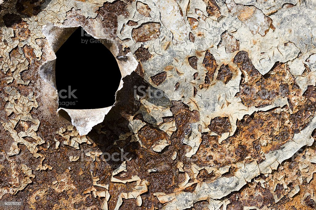 rusty iron texture with big bullet hole royalty-free stock photo