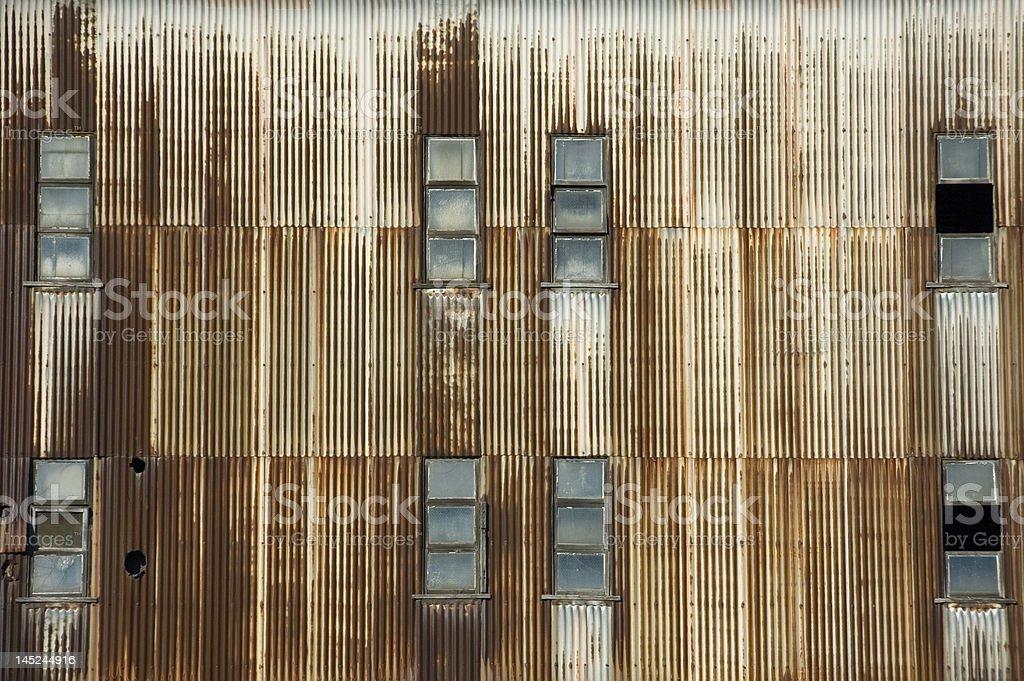 Rusty iron wall with windows royalty-free stock photo