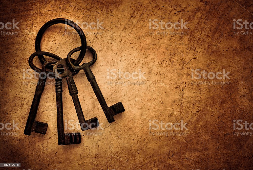 rusty keys on brown paper background royalty-free stock photo