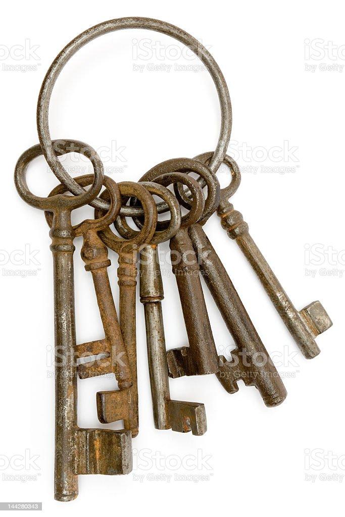Rusty keys sitting on a hook to open many doors stock photo