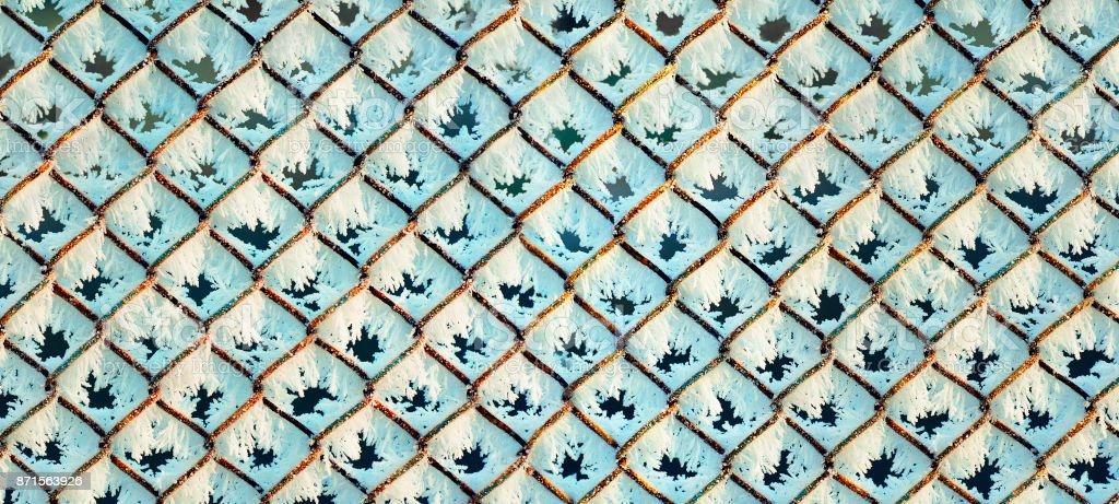 rusty lattice with hoarfrost background, panorama stock photo