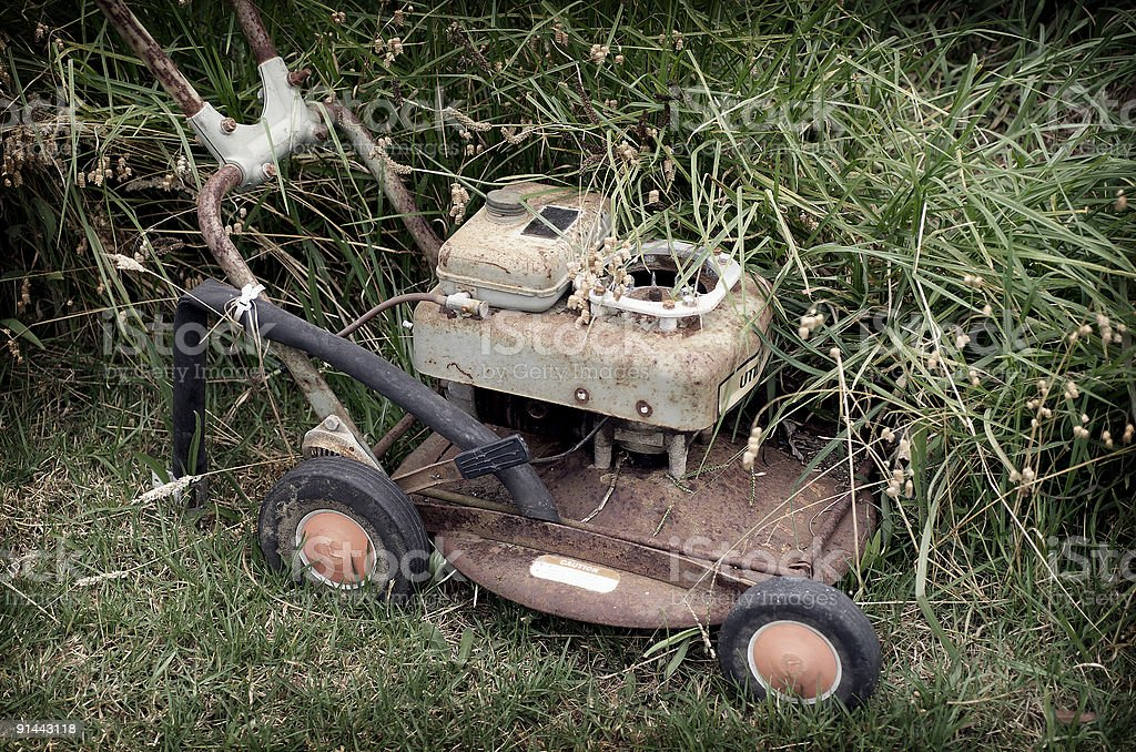 Rusty Lawnmower stock photo