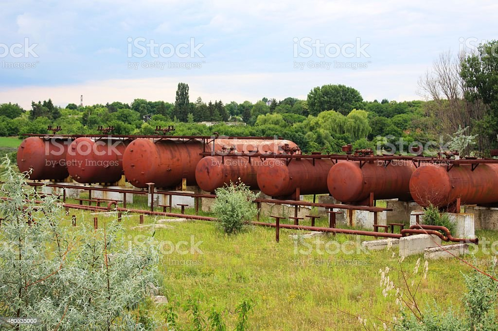 Rusty liquified gas cylinders stock photo