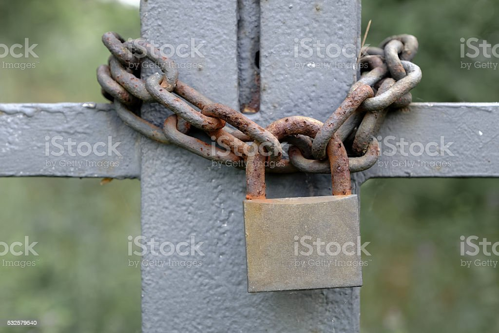 rusty lock and chain closing a gate stock photo
