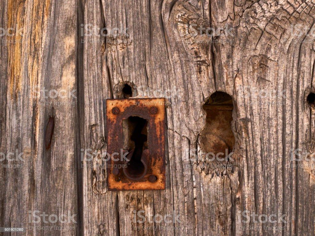 Rusty lock on an old wooden door stock photo