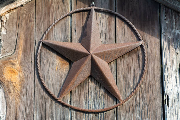 Rusty Lone Star sign on a wooden door in Texas Rusty Lone Star sign on a wooden door in Texas. san antonio texas stock pictures, royalty-free photos & images