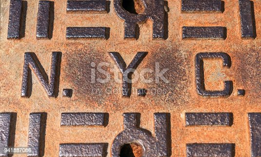 Close-up of a corroded manhole cover in New York City.