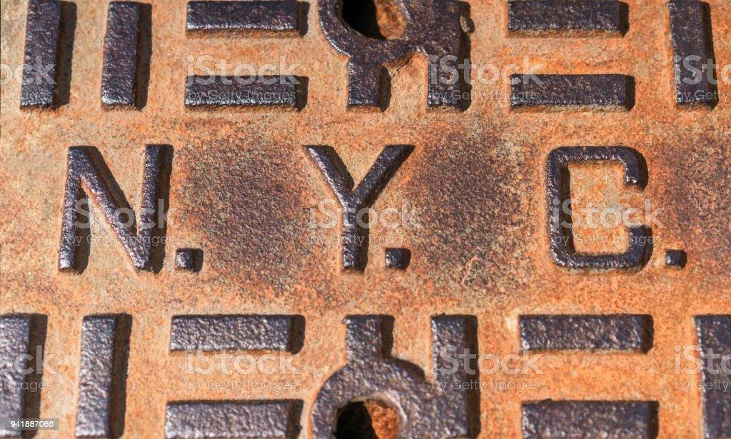 NYC - Rusty manhole cover in New York City stock photo