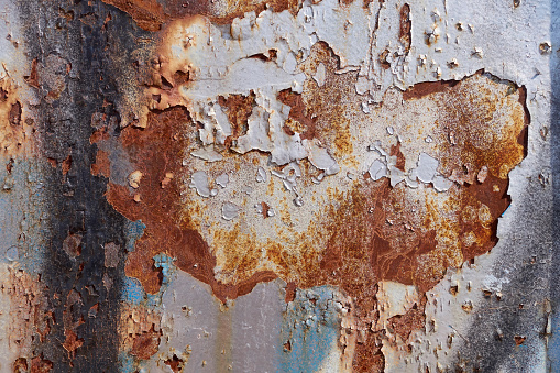 Background of old metal surface painted with white paint. Grunge wall texture