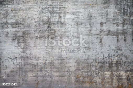 Rusty metal background with gray colors and parts where the color has fallen and is seen rust.