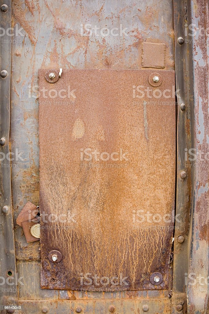 Rusty metal background; side of a bulging boxcar royalty-free stock photo