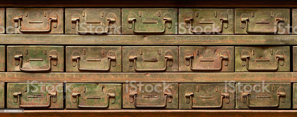 Rusty metal cabinet with drawers stock photo