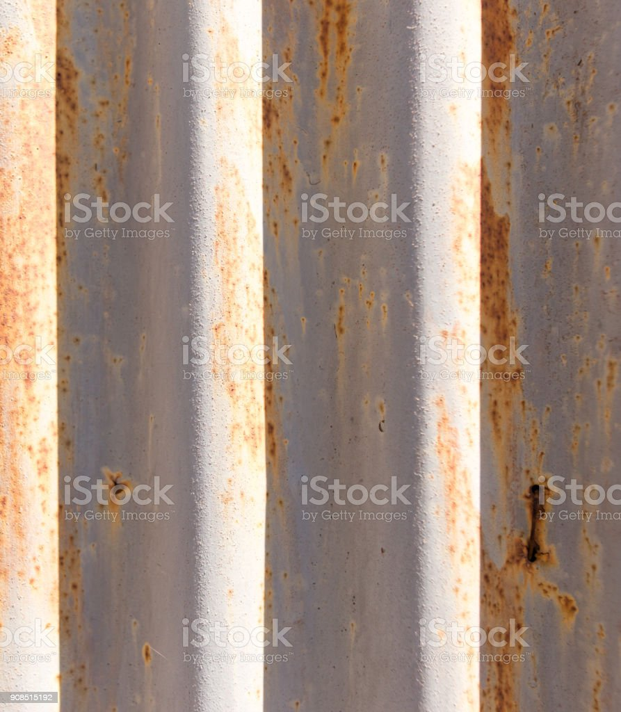 Rusty metal fence as a background stock photo