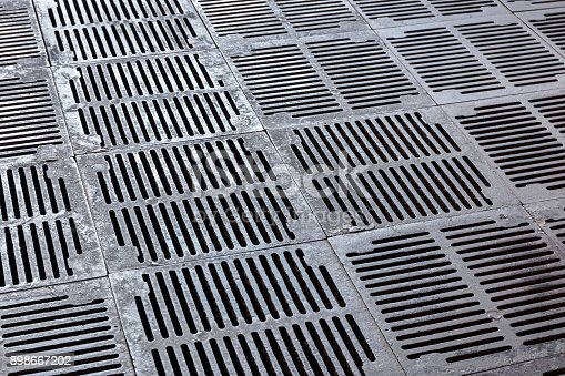 rusty metal grille of sewer. grate of water drain background.
