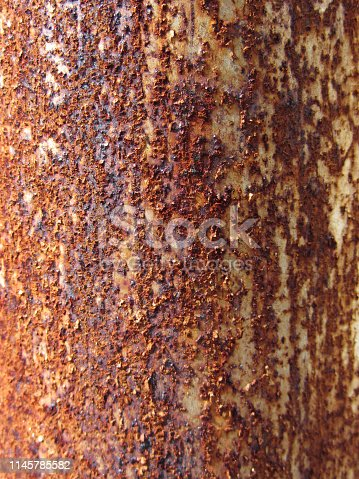 Close-up shot of a rusty metal pipe.