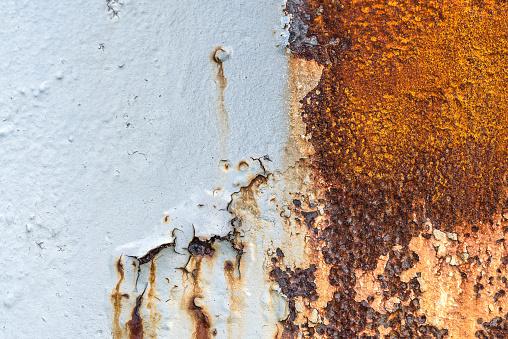 Rusty metallic surface under sunshine.