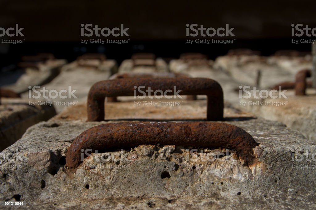 Rusty metal rungs set in concrete stock photo