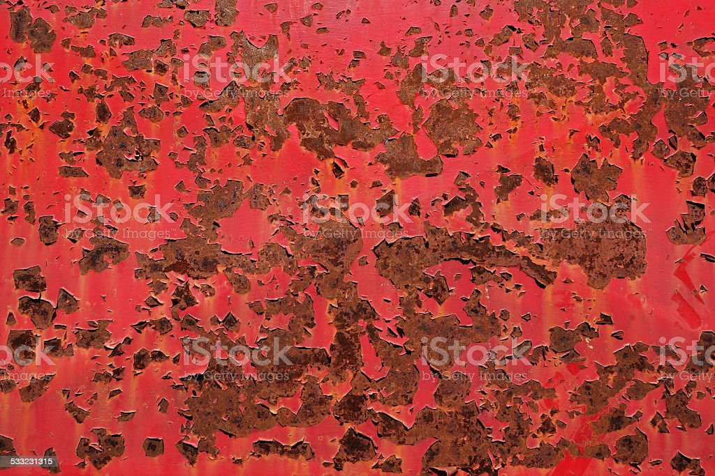 Rusty metal surface with old peeled paint stock photo