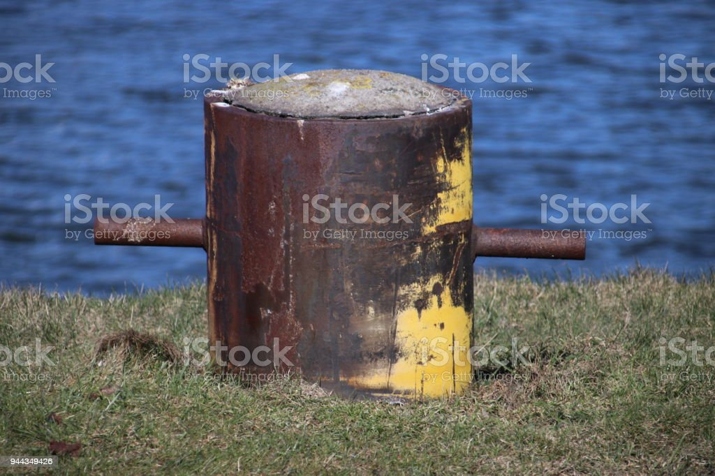 Rusty mooring post in the port of IJmuiden in the Netherlands stock photo