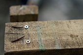 Photo of rusty nail and brown wood