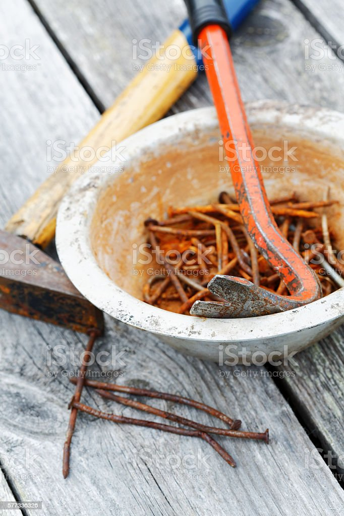 rusty nails and nail puller close-up stock photo