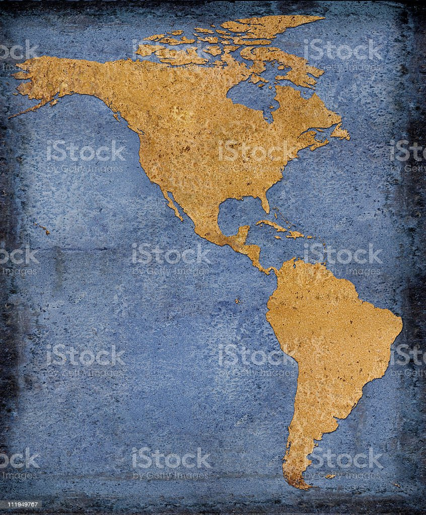 Rusty North and South America on blue background stock photo
