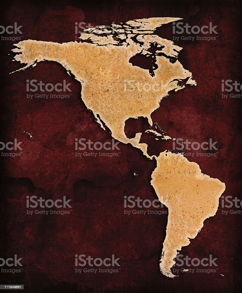 Rusty North and South America on red grunge background royalty-free stock photo