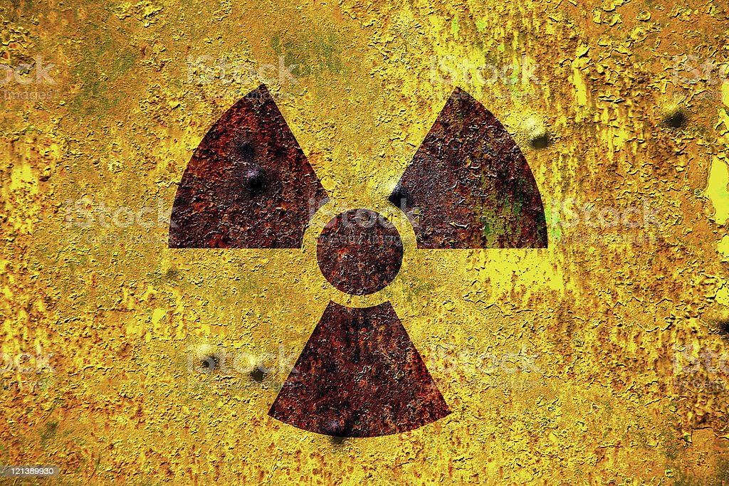 rusty nuclear radiation sign background stock photo