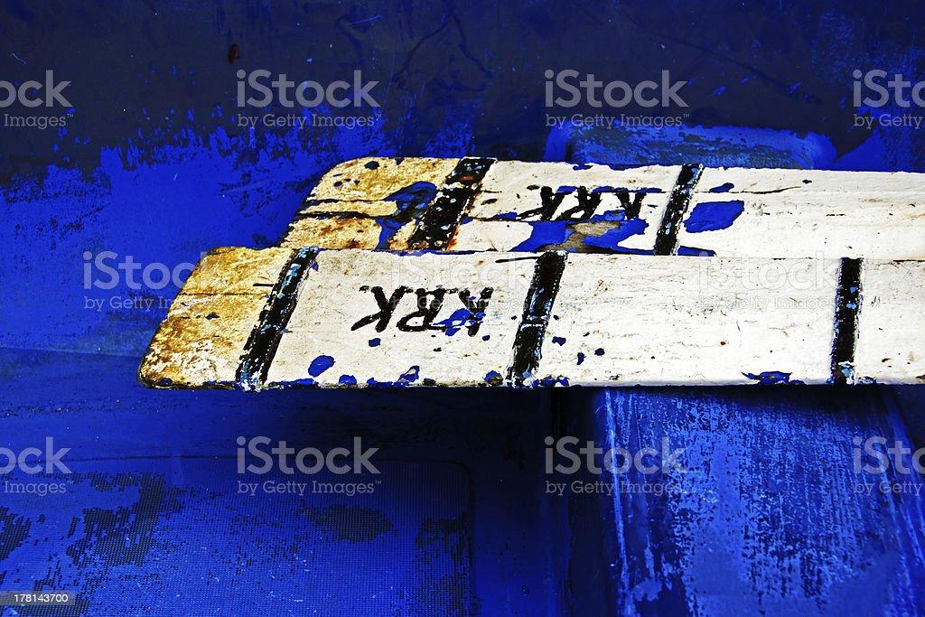 rusty oars in a blue boat royalty-free stock photo