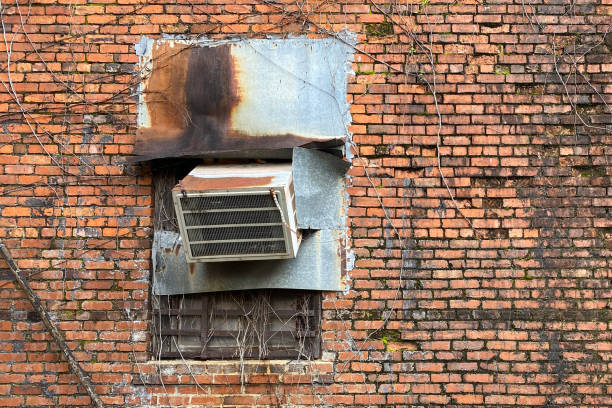 rusty old air conditioner vintage red brick wall stock photo