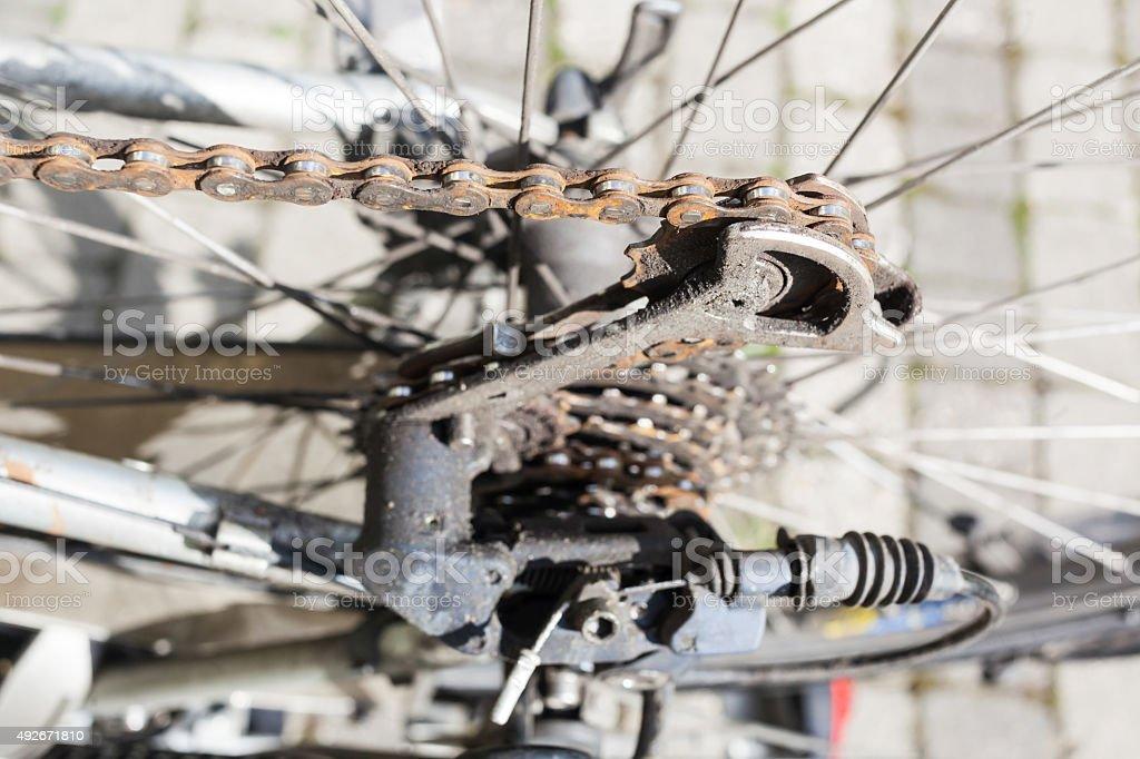 Rusty old bike chain and gear shift stock photo