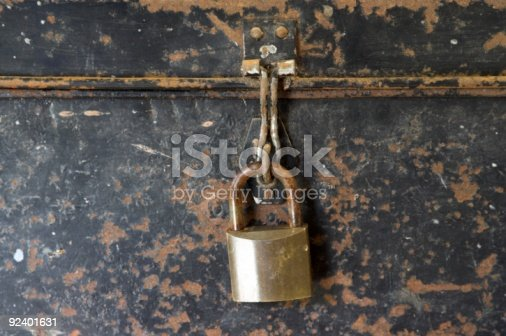 istock Rusty Old Black Tin Box With Brass padlock 92401631