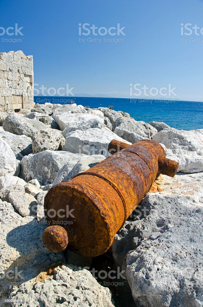 Rusty old cannon in Rhodes island near fort, Greece stock photo