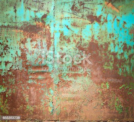 94372741 istock photo Rusty old color grunge green metal wall texture background 655353238