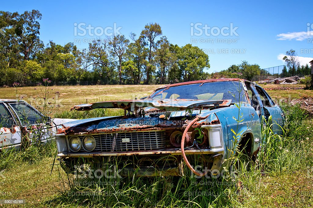 Rusty Old Ford Cars Abandoned In A Field In Australia Stock Photo