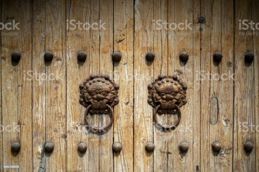 rusty old knocker on weathered wooden door stock photo