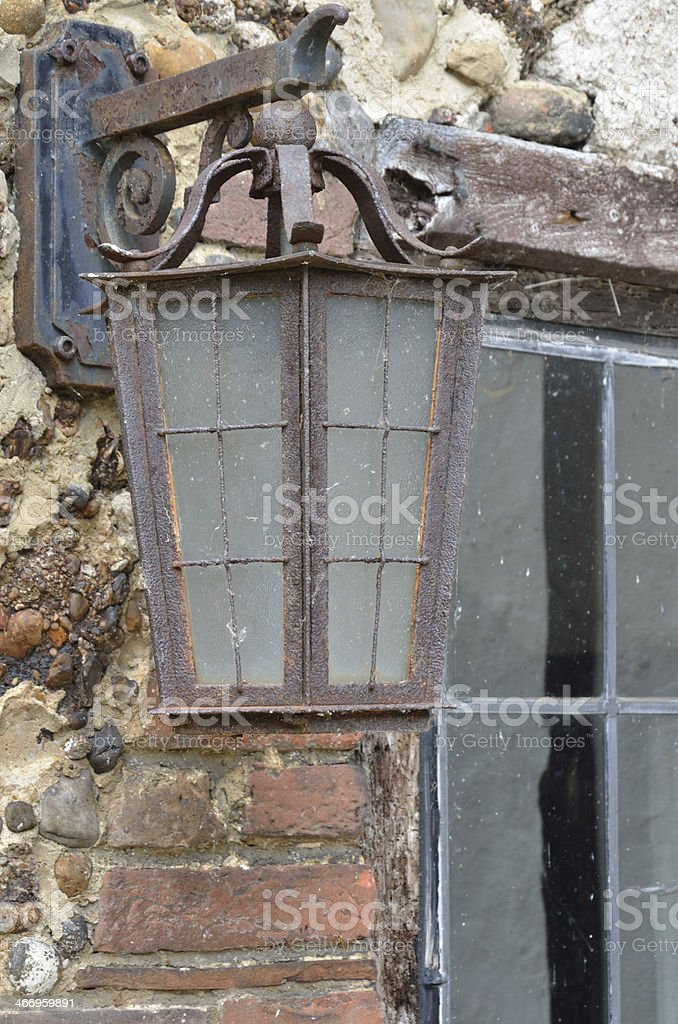 Rusty old lamp on wall royalty-free stock photo